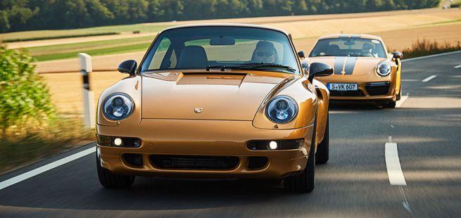 Porsche 993 turbo Gold fährt auf Landstraße vor 991 Turbo S Exclusive Series